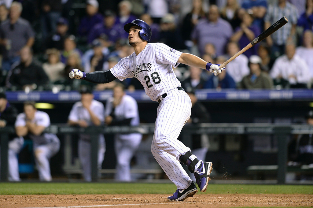 . Colorado batter Nolan Arenado doubled to drive in two runs in the bottom of the ninth inning. The Colorado Rockies defeated the San Francisco Giants 5-4 at Coors Field Tuesday night, May 20, 2014. (Photo by Karl Gehring/The Denver Post)