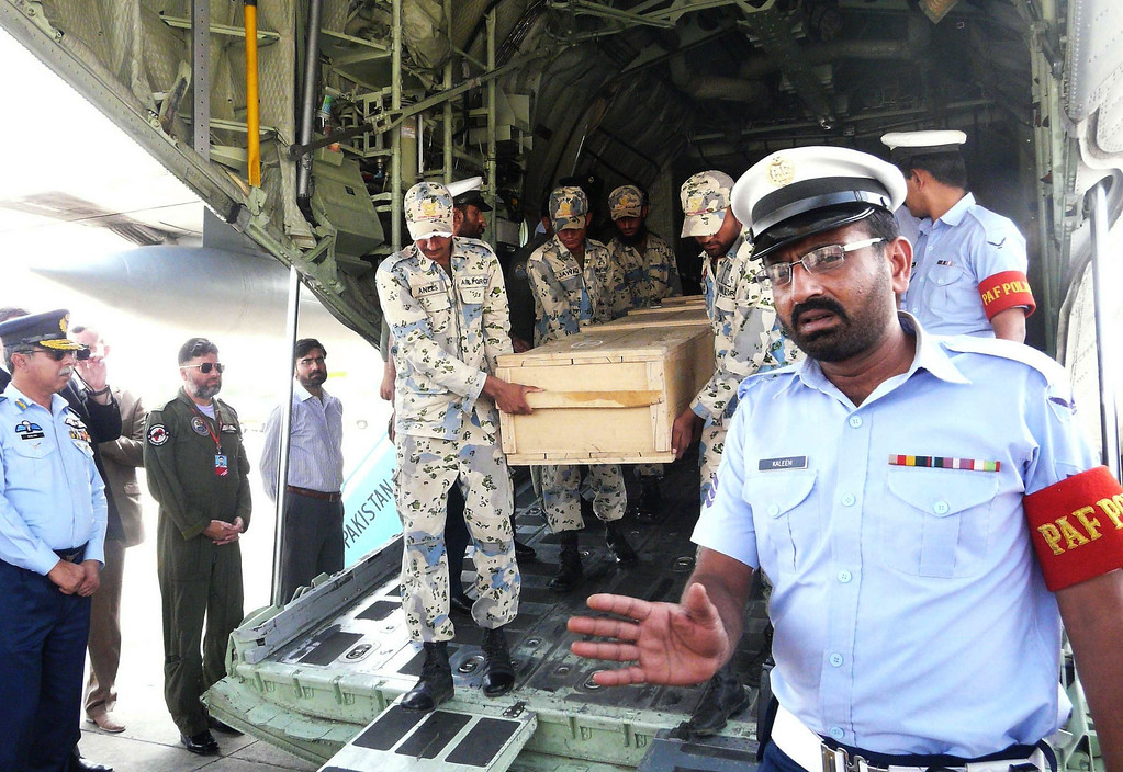 . Pakistani air force personnel carry coffins of foreign tourists as they are unloaded from a C-130 air plane upon arrival at Chaklala airbase in Rawalpindi on June 23, 2013. Gunmen dressed as police killed nine Chinese and Ukrainian tourists in an unprecedented attack in the Pakistani Himalayas claimed by the Taliban, who said they had set up a new faction to target foreigners in revenge for US drone strikes.   AFP/Getty Images