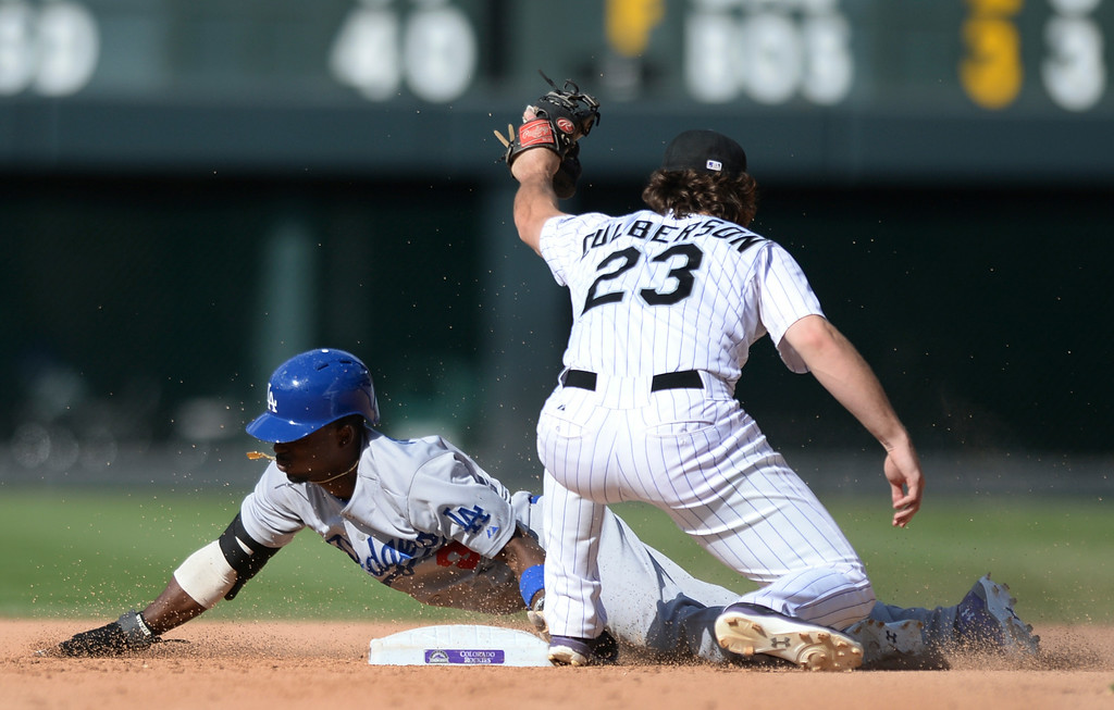 . DENVER, CO - JULY 5:  With a late tag by Colorado infielder Charlie Culberson Dodgers baserunner Dee Gordon had a stolen base in the eighth inning. The Colorado Rockies defeated the Los Angeles Dodgers 8-7 at Coors Field Saturday afternoon, July 5, 2014.  Photo by Karl Gehring/The Denver Post