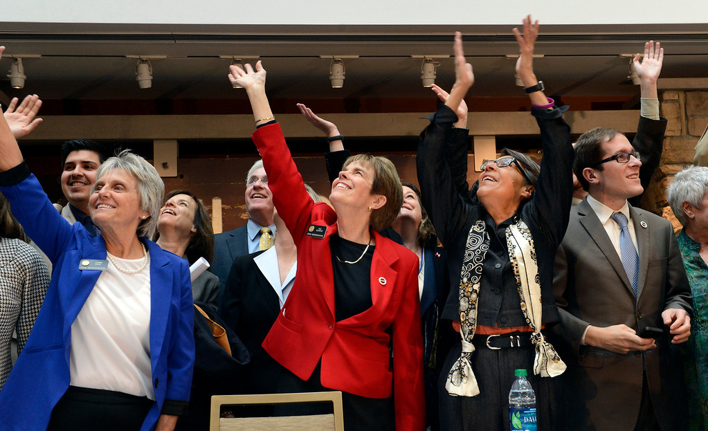 . DENVER, CO. - MARCH 21: (l-r) Lawmakers Reps. Joann Gilnal and Sue Schafer, Sen Lucia Guzman and Speaker Mark Ferrandino wave to the crowd during a bill signing ceremony in  Denver, CO March 21, 2013. Gov. John Hickenlooper signed the Colorado Civil Union Act, making Colorado one of 18 states that offer recognition of same-sex couples, either through marriage or civil unions, according to the state\'s largest gay-rights group, One Colorado. The bill was sponsored by four openly gay lawmakers, Senators Pat Steadman and Lucia Guzman, Representative Sue Schafer, and Speaker Mark Ferrandino. (Photo By Craig F. Walker/The Denver Post)