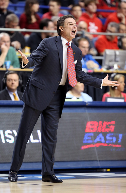 . LEXINGTON, KY - MARCH 23: Head coach Rick Pitino of the Louisville Cardinals looks on from the sideline in the first half against the Colorado State Rams during the third round of the 2013 NCAA Men\'s Basketball Tournament at Rupp Arena on March 23, 2013 in Lexington, Kentucky.  (Photo by Andy Lyons/Getty Images)