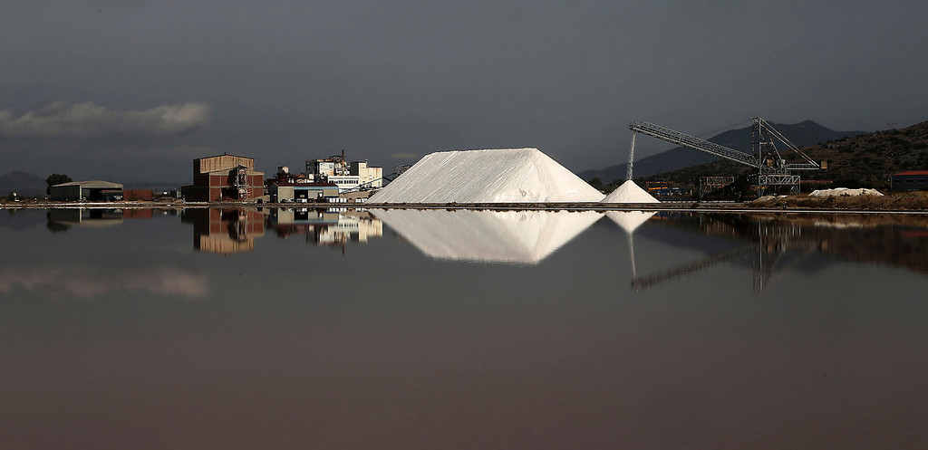 . Piles of salt are stored at a production site in Messolongi, western Greece. Salt lakes at Messolongi are used for production by solar evaporation. The facilities are the largest saltworks in Greece, and are located at a protected wetland complex of estuaries and lagoons. (AP Photo/Dimitri Messinis)