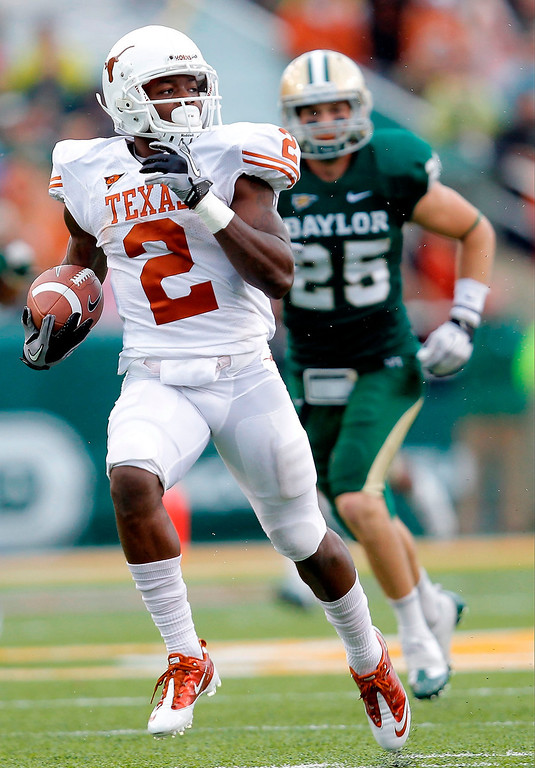 . Marquise Goodwin #2 of the Texas Longhorns runs during a game against the Baylor Bears at Floyd Casey Stadium on December 3, 2011 in Waco, Texas.  (Photo by Sarah Glenn/Getty Images)