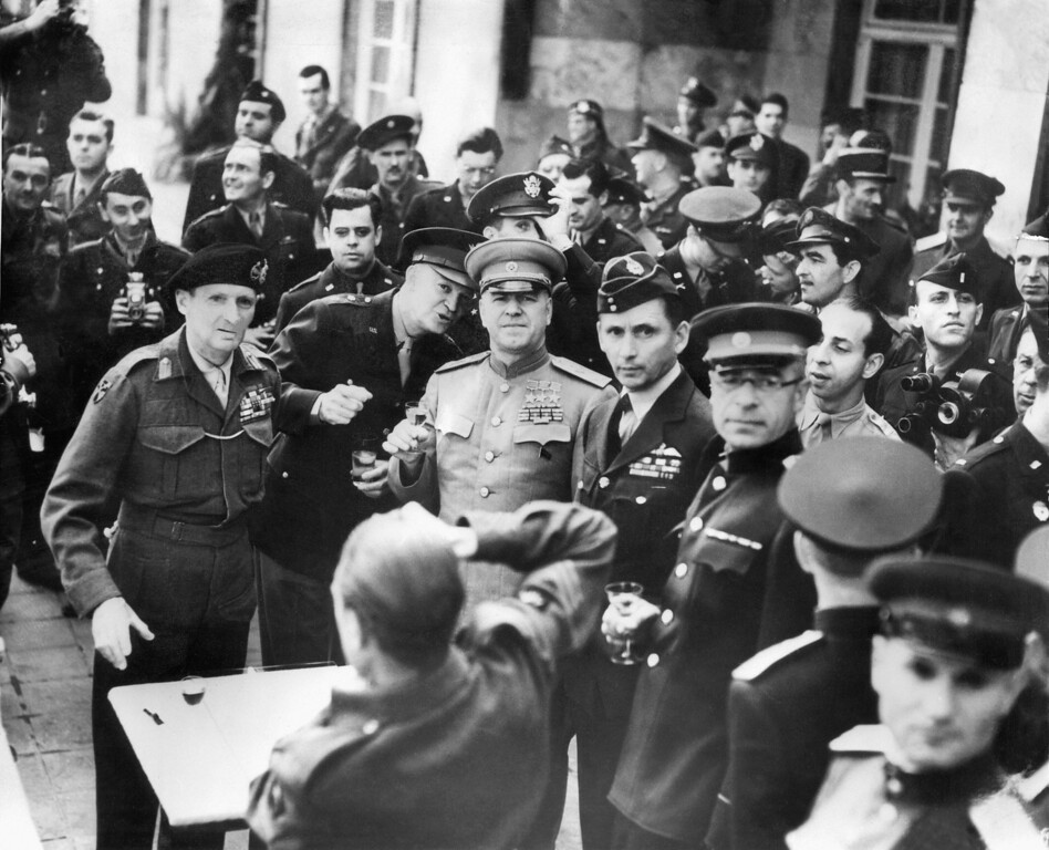 . FRANKFURT, GERMANY:  (FILES) A picture taken 07 May 1945 in Frankfurt am Main shows (from L) British Field Marshal Bernard Montgomery, US General Dwight D. Eisenhower, Soviet Marshal Gregori Zhukov and British Air Chief Marshal Arthud Tedder, toasting in Frankfurt after the signing of the German surrender in Reims. The date that World War II finally came to an end in Europe is still a matter for debate. For the British and Americans it ended on May 7, 1945 with the signing of the German surrender in Reims. For the Russians, it was the signature of the unconditional surrender in Berlin on May 9 and for the French it remains May 8, the day the fighting actually came to a halt. STF/AFP/Getty Images