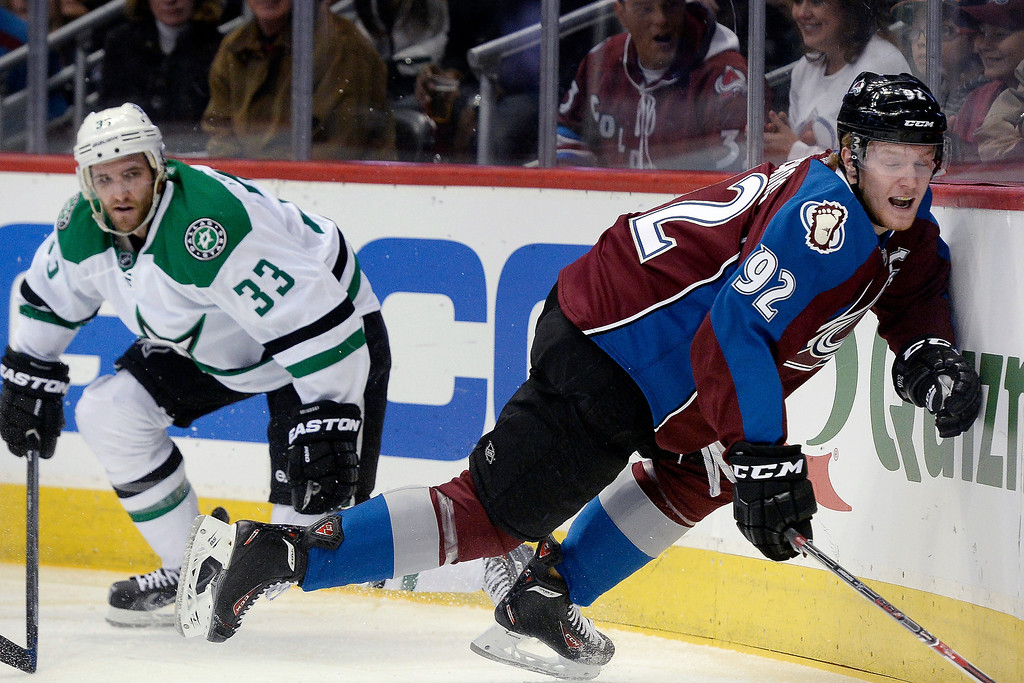 . Colorado Avalanche left wing Gabriel Landeskog (92) hits the boards while being defended by Dallas Stars defenseman Alex Goligoski (33) during the first period. (Photo by AAron Ontiveroz/The Denver Post)