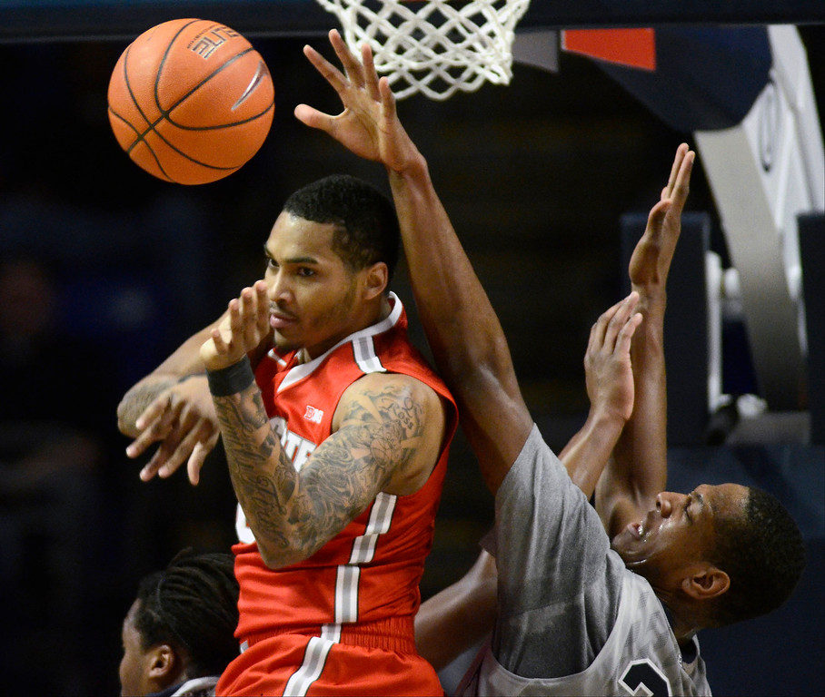 . Ohio State\'s LaQuinton Ross loses control of a rebound as Penn State\'s Jordan Dickerson reaches in during the first half of an NCAA college basketball game on Thursday, Feb. 27, 2014, in State College, Pa. (AP Photo/Ralph Wilson)