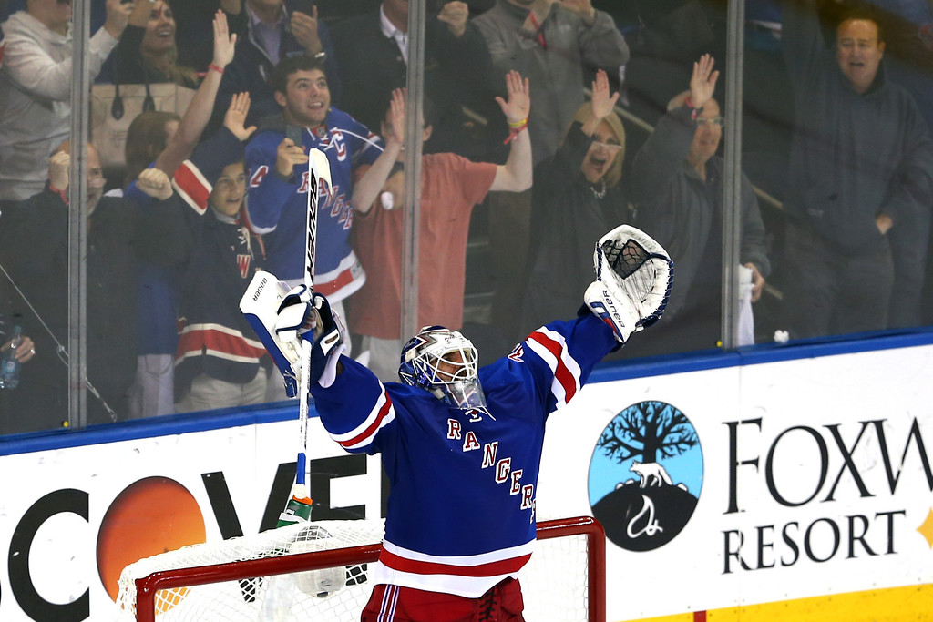 . Henrik Lundqvist #30 of the New York Rangers celebrates after defeating the Montreal Canadiens in Game Six of the Eastern Conference Final in the 2014 NHL Stanley Cup Playoffs at Madison Square Garden on May 29, 2014 in New York City. The New York Rangers defeated the Montreal Canadiens 1 to 0.  (Photo by Elsa/Getty Images)