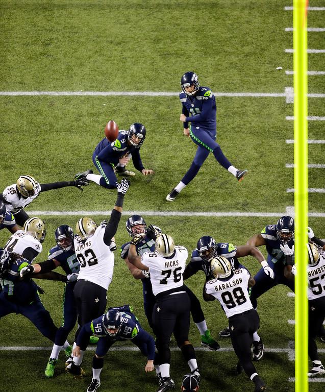 . Seattle Seahawks kicker Steven Hauschka, upper right, kicks a field goal as Seahawks\' Jon Ryan holds in the first half of an NFL football game against the New Orleans Saints, Monday, Dec. 2, 2013, in Seattle. (AP Photo/John Froschauer)