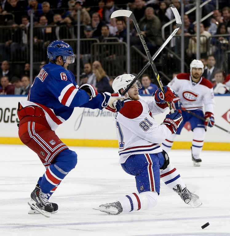 . Montreal Canadiens center Lars Eller (81) battles New York Rangers defenseman Anton Stralman (6) for the puck during the third period in Game 6 of the NHL hockey Stanley Cup playoffs Eastern Conference finals, Thursday, May 29, 2014, in New York. (AP Photo/Kathy Willens)