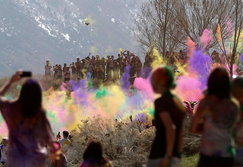 . Spectators watch as participants dance and throw colored chalk during the Holi Festival of Colors at the Sri Sri Radha Krishna Temple in Spanish Fork, Utah, March 30, 2013.  REUTERS/Jim Urquhart