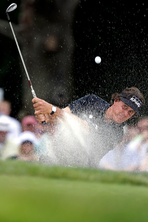 . Phil Mickelson hits out of a bunker on the second hole during the fourth round of the U.S. Open golf tournament at Merion Golf Club, Sunday, June 16, 2013, in Ardmore, Pa. (AP Photo/Darron Cummings)