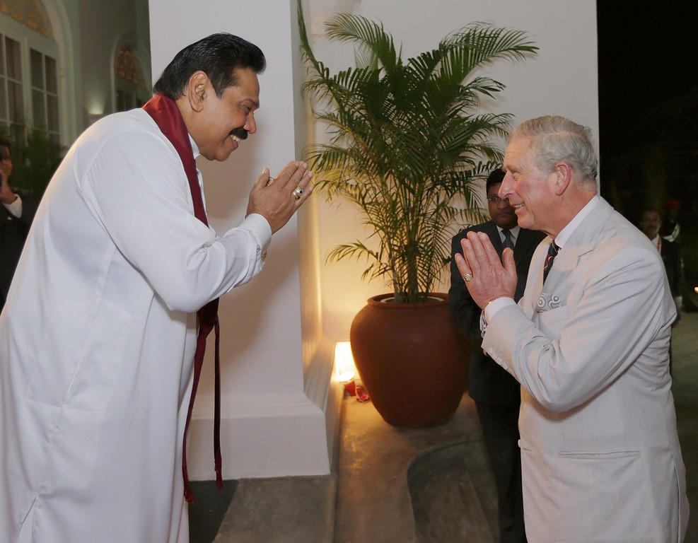 . In this handout photo provided by Sri Lankan Government, Sri Lankan President Mahinda Rajapaksa (L) greets Prince Charles, Prince of Wales during a reception at the President\'s House on November 14, 2013 in Colombo, Sri Lanka.   (Photo by Sri Lankan Government via Getty Images)
