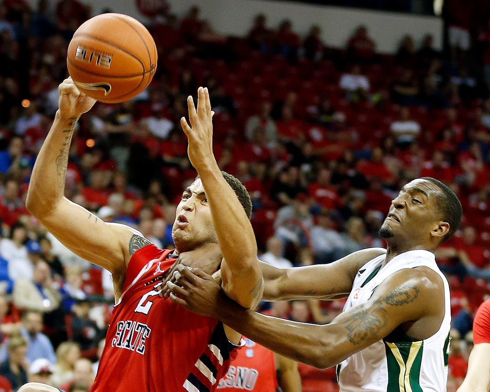 . Fresno State\'s Braeden Anderson, left, and Colorado State\'s Greg Smith try to pull down a rebound during the second half of a Mountain West Conference tournament NCAA college basketball game on Wednesday, March 13, 2013, in Las Vegas. Colorado State defeated Fresno State 67-61. (AP Photo/Isaac Brekken)