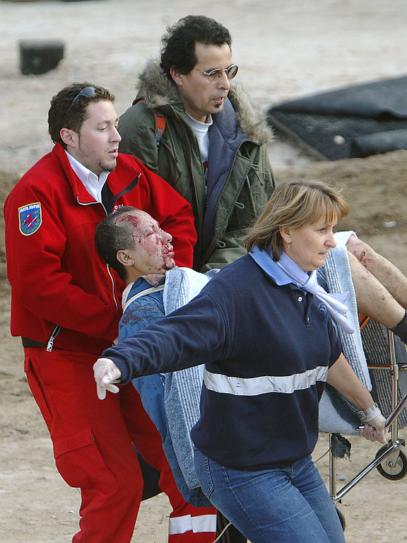 . Rescue workers evacuate an injured person after a train exploded at the Atocha train station in Madrid 11 March 2004. At least 173 people were killed and some 600 injured early 11 March 2004 in near-simultaneous explosions on three trains in Madrid at the height of morning commuter traffic, the Spanish interior ministry said. In what appeared to be a deliberate attack staged only 72 hours ahead of Spanish general elections, the blasts went off on a long-distance high-speed carrier and two suburban trains packed with commuters. PIERRE-PHILIPPE MARCOU/AFP/Getty Images