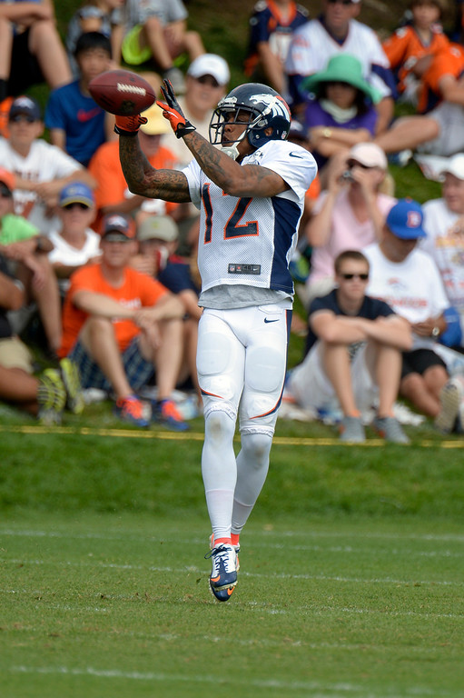 . Denver Broncos WR Andre Caldwell (12) catches a pass during training camp August 1, 2013 at Dove Valley. (Photo By John Leyba/The Denver Post)