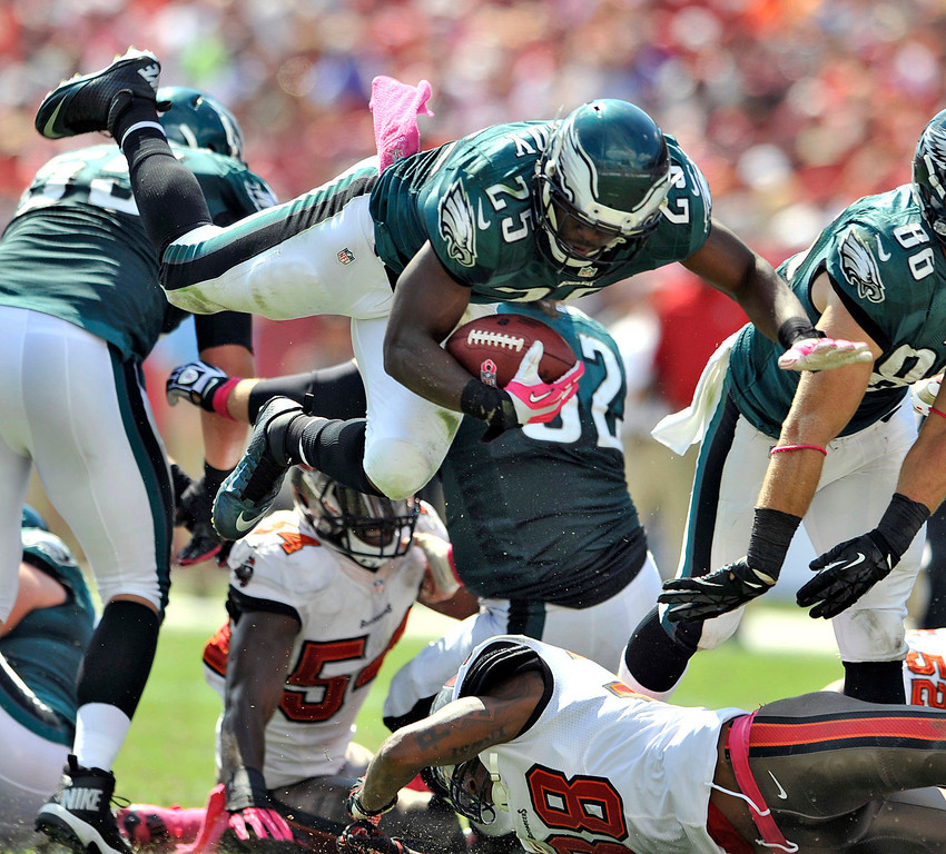 . Philadelphia Eagles running back LeSean McCoy (25) is sent flying on a hit from Tampa Bay Buccaneers free safety Dashon Goldson (38) during the second quarter of an NFL football game Sunday, Oct. 13, 2013, in Tampa, Fla. (AP Photo/Steve Nesius)
