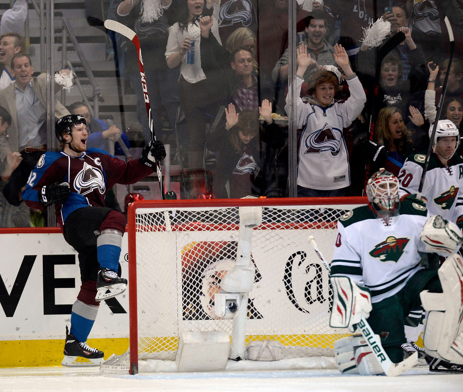 . Gabriel Landeskog (92) of the Colorado Avalanche celebrates his first goal in the second period of action as goalie Ilya Bryzgalov (30) of the Minnesota Wild looks up at the scoreboard. The Colorado Avalanche hosted the Minnesota Wild in the first round of the Stanley Cup Playoffs at the Pepsi Center in Denver, Colorado on Saturday, April 19, 2014. (Photo by John Leyba/The Denver Post)