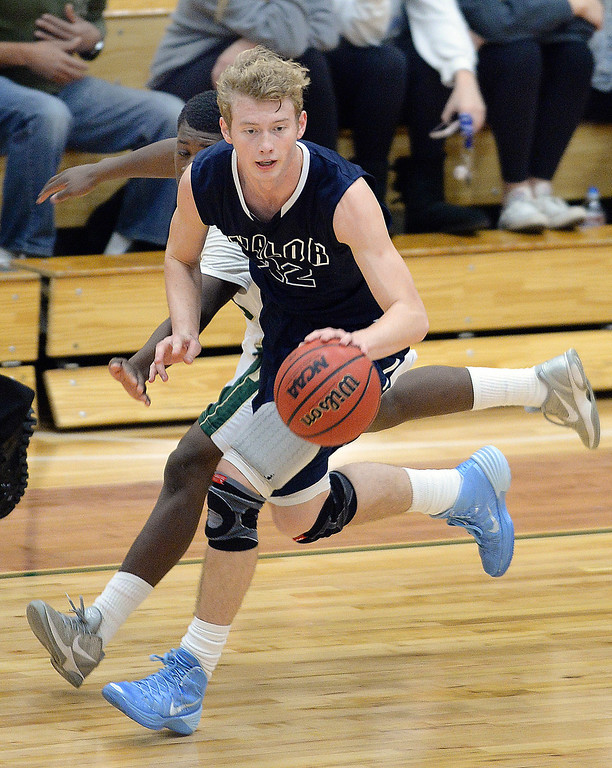 . Eagles\' senior Chase Foster (22) kept the ball from Trojans\' sophomore Marquise Johnson (35) following a turnover in the second half. The Valor Christian High School boy\'s basketball team defeated Aurora Central 60-52 Wednesday night, January 8, 2014. Photo By Karl Gehring/The Denver Post