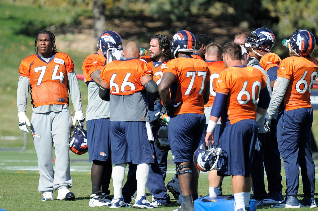 . Denver Broncos offensive line gets a water break during practice October 24, 2013 at Dove Valley. (Photo by John Leyba/The Denver Post)