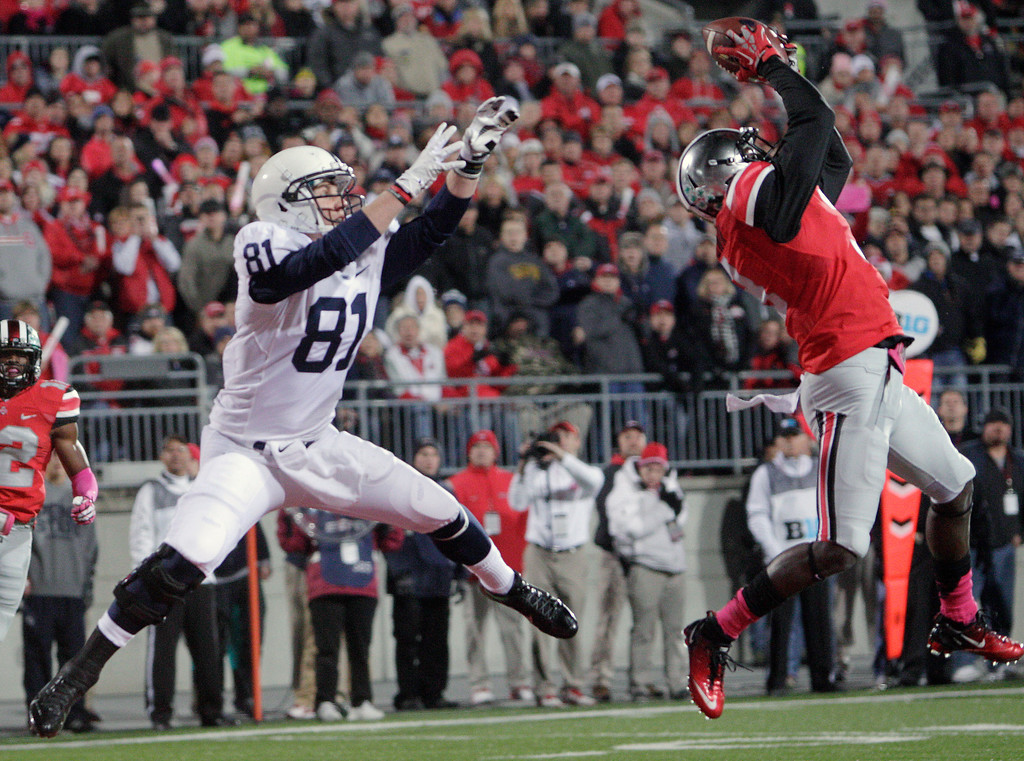 . Ohio State defensive back Corey Brown, right, grabs an interception in the end zone in front of Penn State tight end Adam Breneman during the first quarter of an NCAA college football game Saturday, Oct. 26, 2013, in Columbus, Ohio. (AP Photo/Jay LaPrete)