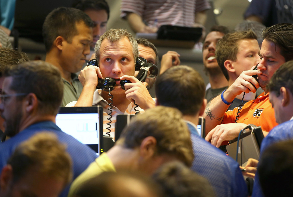 . CHICAGO, IL - OCTOBER 16:  Traders take orders in the Standard & Poor\'s 500 stock index options pit at the Chicago Board Options Exchange (CBOE) on October 16, 2013 in Chicago, Illinois. The major stock indices reacted favorably today as it appeared a deal that would end the government shutdown was close to being reached.  (Photo by Scott Olson/Getty Images)