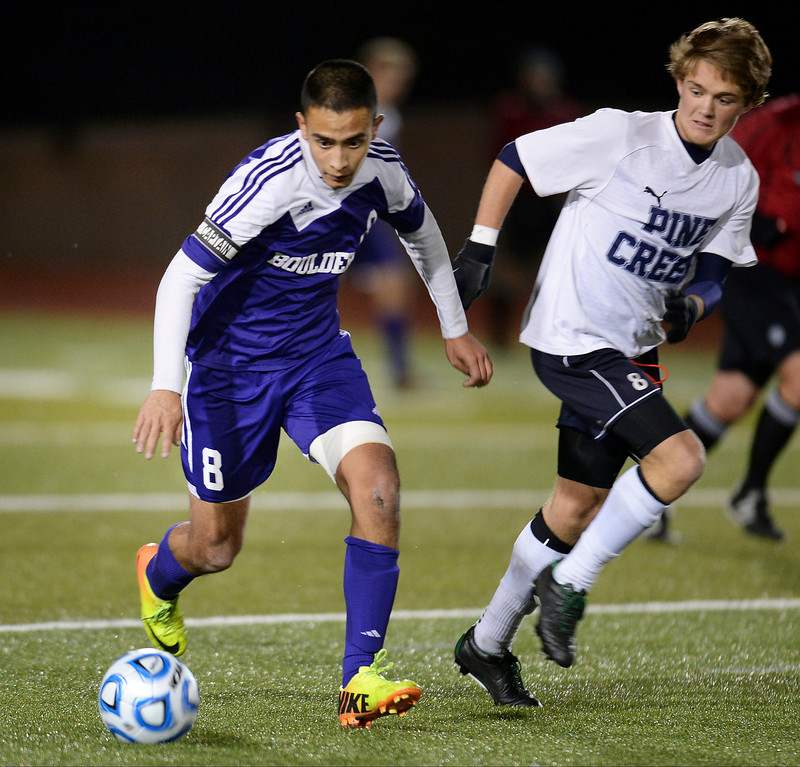 . Javier Castruita of Boulder High School (8), left, controls the ball against Jack Raynolds of Pine Creek High School (8) during their 5A semifinal game at Legacy Stadium. (Photo by Hyoung Chang/The Denver Post)