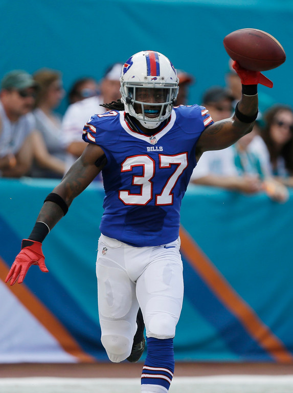. Buffalo Bills defensive back Nickell Robey (37) shows off the ball after he intercepted a pass by Miami Dolphin\'s quarterback Ryan Tannehill for a touchdown and during the first half of an NFL football game, Sunday, Oct. 20, 2013, in Miami Gardens, Fla. (AP Photo/Lynne Sladky)