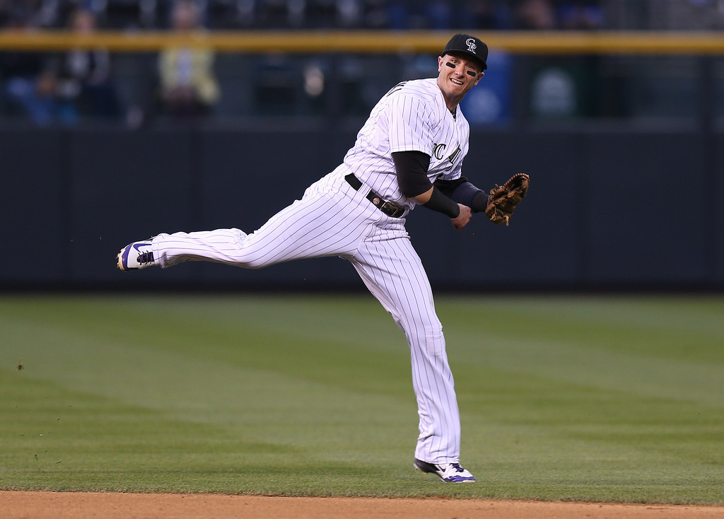 . Colorado Rockies shortstop Troy Tulowitzki throws to first base to out Atlanta Braves\' B.J. Upton to end the top of the sixth inning of a baseball game in Denver on Wednesday, June 11, 2014. (AP Photo/David Zalubowski)