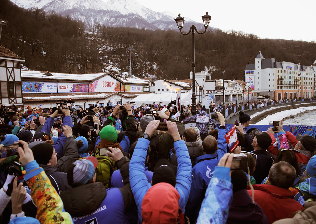 . Olympic fans gather at the Rosa Khutor Live Site to catch the arrival of the Olympic Flame at Rosur Khutor on February 5, 2014 in Sochi, Russia.  (Photo by Adam Pretty/Getty Images)
