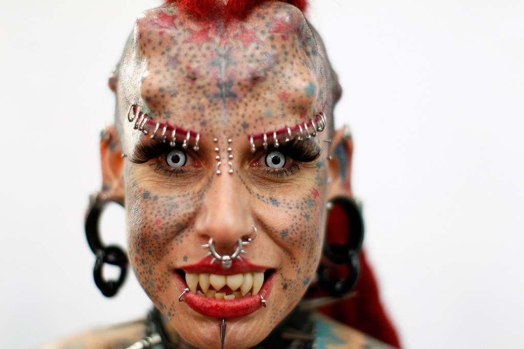 ". Mexican tattoo star Mary Jose Cristerna, better known as the ""La Mujer Vampiro\"" (Female Vampire), poses during a tattoo exhibition in Caracas January 27, 2012. REUTERS/Jorge Silva"