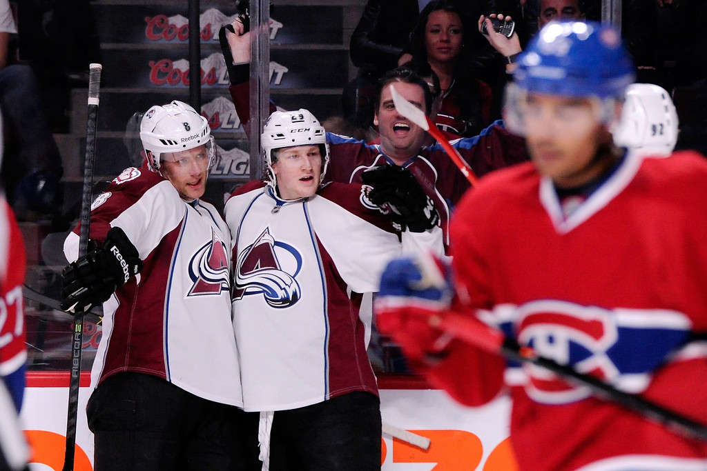 . MONTREAL, QC - MARCH 18:  Nathan MacKinnon #29 of the Colorado Avalanche celebrates his first-period goal with teammates during the NHL game against the Montreal Canadiens at the Bell Centre on March 18, 2014 in Montreal, Quebec, Canada.  (Photo by Richard Wolowicz/Getty Images)