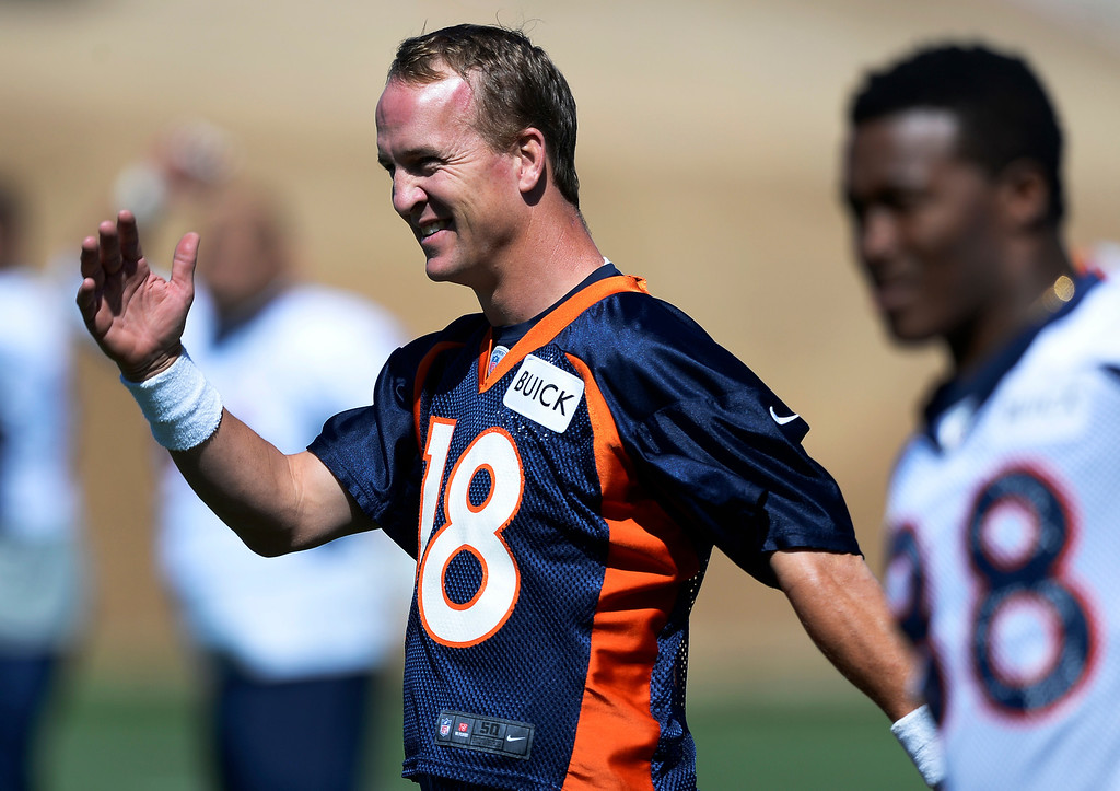 . Denver Broncos quarterback Peyton Manning (18) stretches during OTAs June 2, 2014 at Dove Valley. (Photo by John Leyba/The Denver Post)