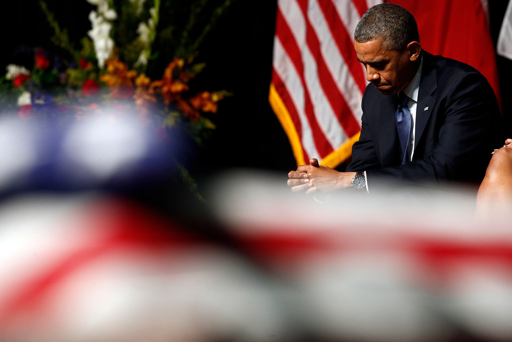 . President Barack Obama attends the memorial for firefighters killed at the fertilizer plant explosion in West, Texas, at Baylor University in Waco, Texas, Thursday, April 25, 2013. (AP Photo/Charles Dharapak)