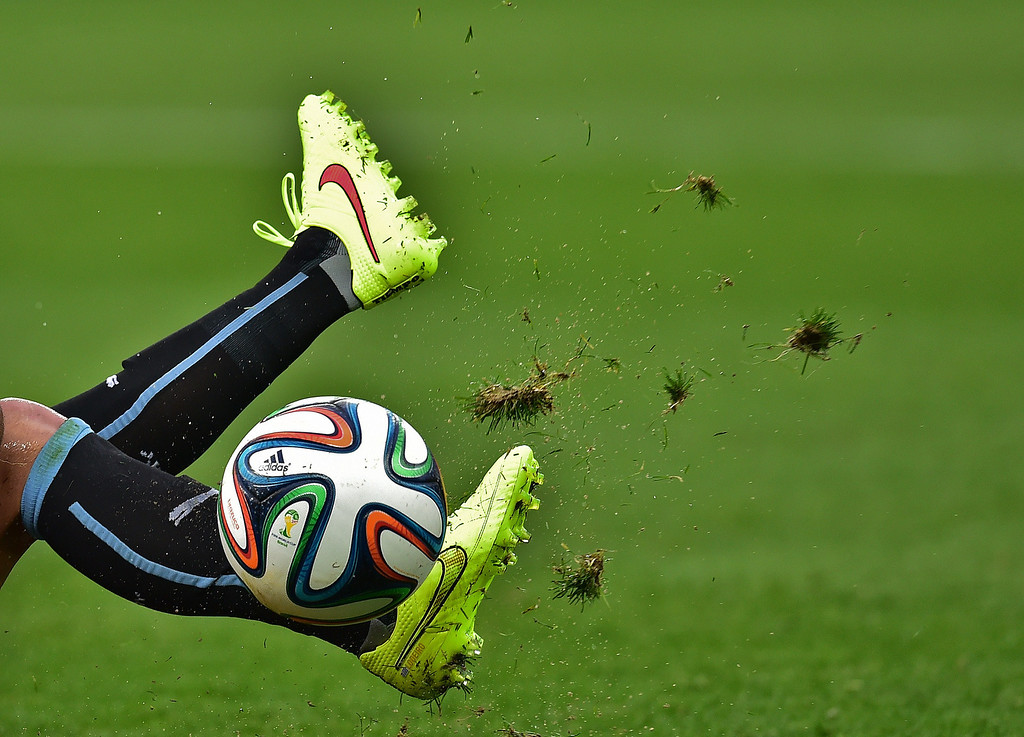 . A Uruguayan player kicks the ball during the Group D football match between Uruguay and England at the Corinthians Arena in Sao Paulo on June 19, 2014, during the 2014 FIFA World Cup. NELSON ALMEIDA/AFP/Getty Images