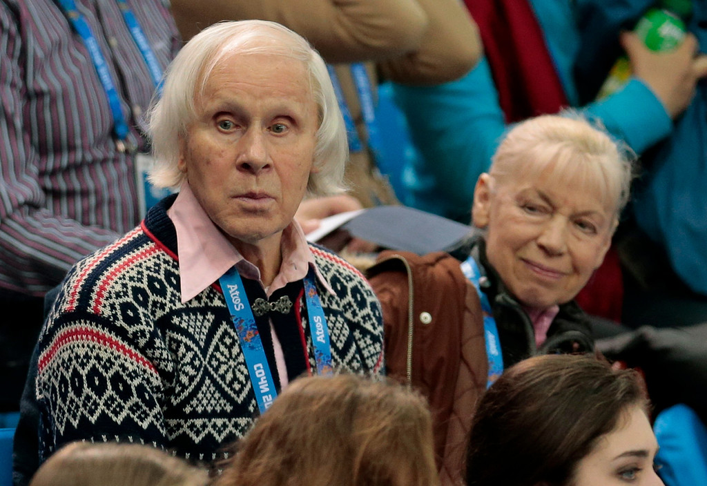 Description of . Russian pair skaters Ludmila Belousova, right, and Oleg Protopopov, the 1964 and 1968 Olympic gold medalists, attend the pairs short program figure skating competition at the Iceberg Skating Palace during the 2014 Winter Olympics, Tuesday, Feb. 11, 2014, in Sochi, Russia. (AP Photo/Ivan Sekretarev)