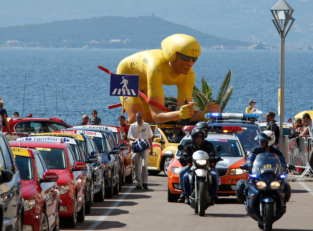 . Publicity vehicles from the Tour de France caravan make their way during the 145,5 km third stage of the centenary Tour de France cycling race from Ajaccio to Calvi, on the French Mediterranean island of Corsica July 1, 2013.   REUTERS/Eric Gaillard