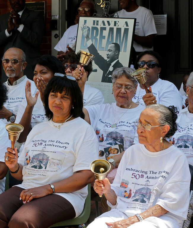 """. Jeanne Smiley, front right, of Montgomery, Ala., rings her bell along with others during ceremonies honoring the 50th anniversary of the Martin Luther King Jr., \""""I Have a Dream\"""" speech in Montgomery, Ala., Wednesday, Aug. 28, 2013. The ceremony took place outside the Dexter Ave. King Memorial Baptist Church where King was pastor from 1954 through 1960.. Smiley said \""""Rev. King was a great man who helped make this country a better place to live.\"""" (AP Photo/Dave Martin)"""