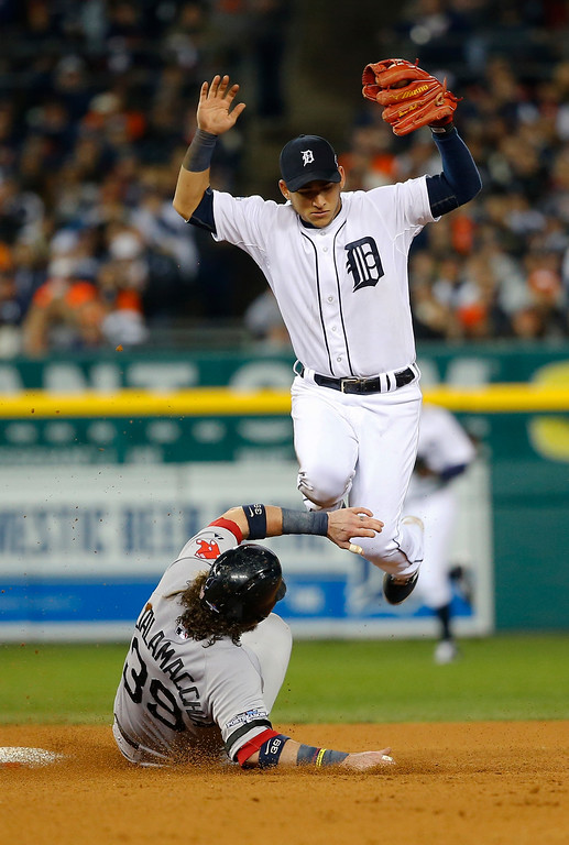 . Detroit Tigers\' Jose Iglesias jumps after forcing out on Boston Red Sox\'s Jarrod Saltalamacchia at second base in the sixth inning during Game 4 of the American League baseball championship series Wednesday, Oct. 16, 2013, in Detroit. (AP Photo/Paul Sancya)