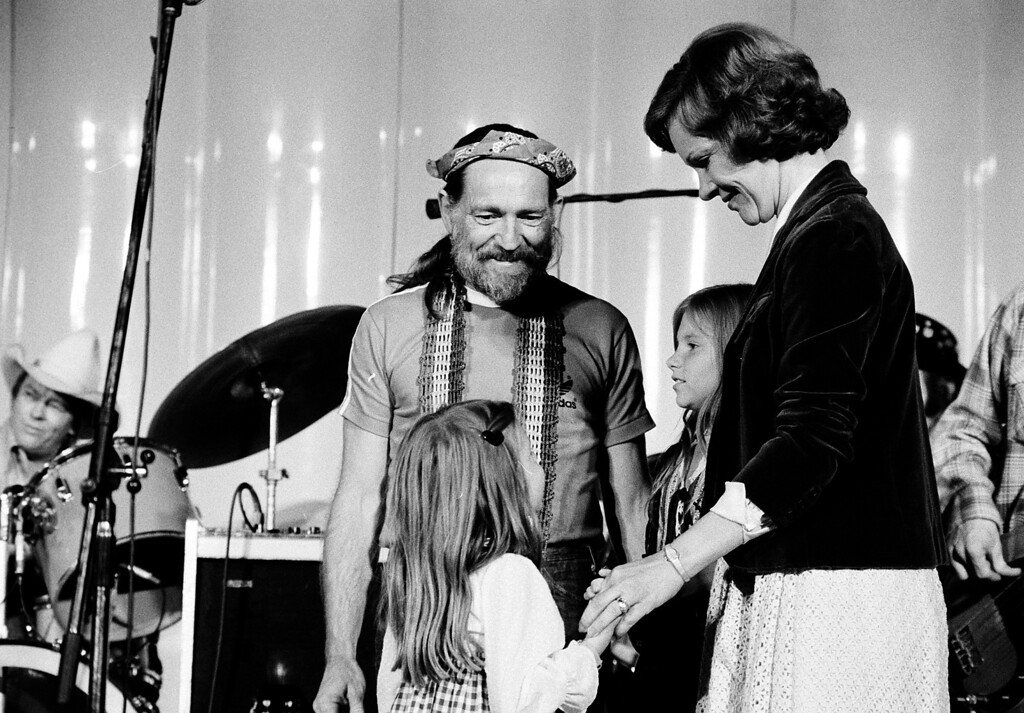 . Country music singer Willie Nelson and his children Amy, left, and Paula talk with first lady Rosalynn Carter at the White House after Nelson performed for members of the NASCAR in Washington, D.C., Sept. 23, 1978.  (AP Photo)