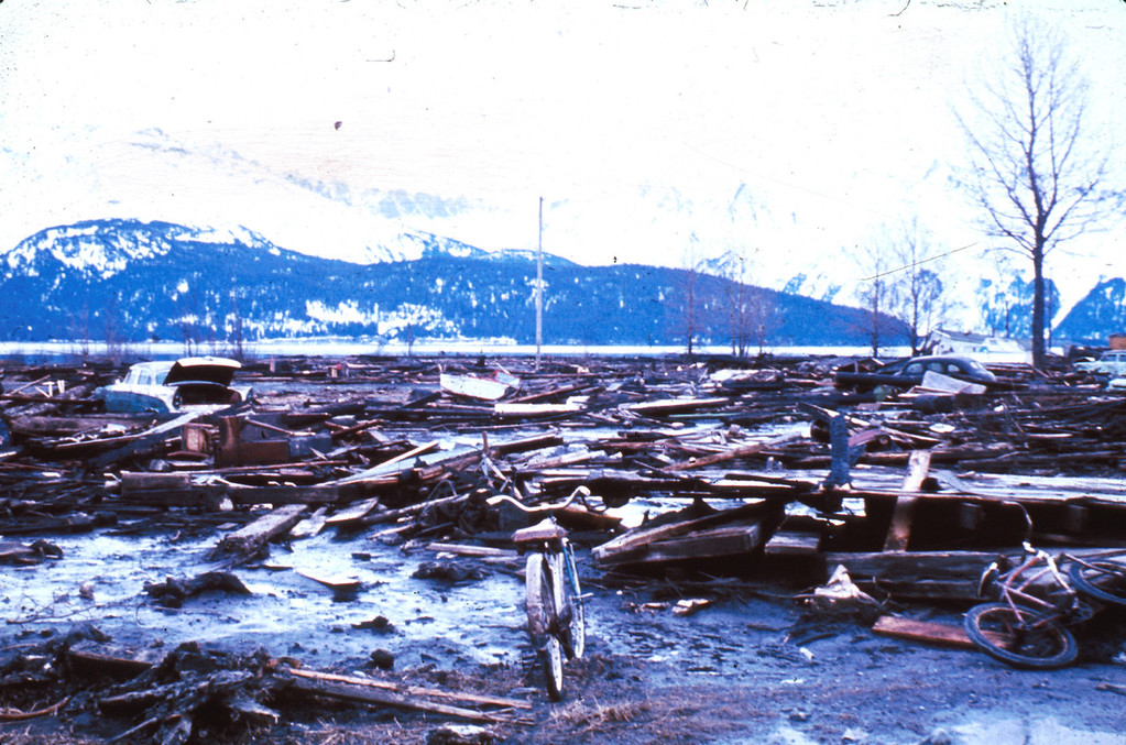 . Tsunami damage at Seward. The waves came in from the sea via Resurrection Bay in the background. 1964. U.S. Geological Survey photo