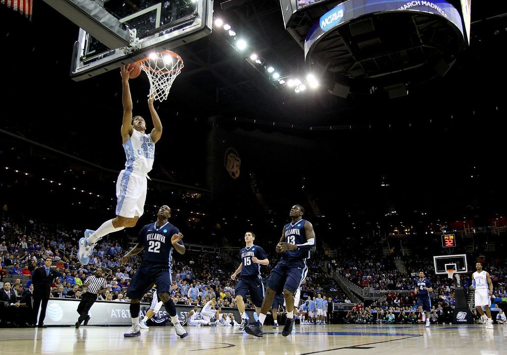 . KANSAS CITY, MO - MARCH 22: James Michael McAdoo #43 of the North Carolina Tar Heels shoots against JayVaughn Pinkston #22 of the Villanova Wildcats in the first half during the second round of the 2013 NCAA Men\'s Basketball Tournament at the Sprint Center on March 22, 2013 in Kansas City, Missouri.  (Photo by Jamie Squire/Getty Images)