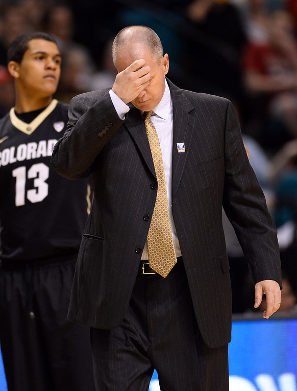 . LAS VEGAS, NV - MARCH 14:  Head coach Tad Boyle of the Colorado Buffaloes reacts during a semifinal game of the Pac-12 Basketball Tournament against the Colorado Buffaloes at the MGM Grand Garden Arena on March 14, 2014 in Las Vegas, Nevada.  (Photo by Ethan Miller/Getty Images)
