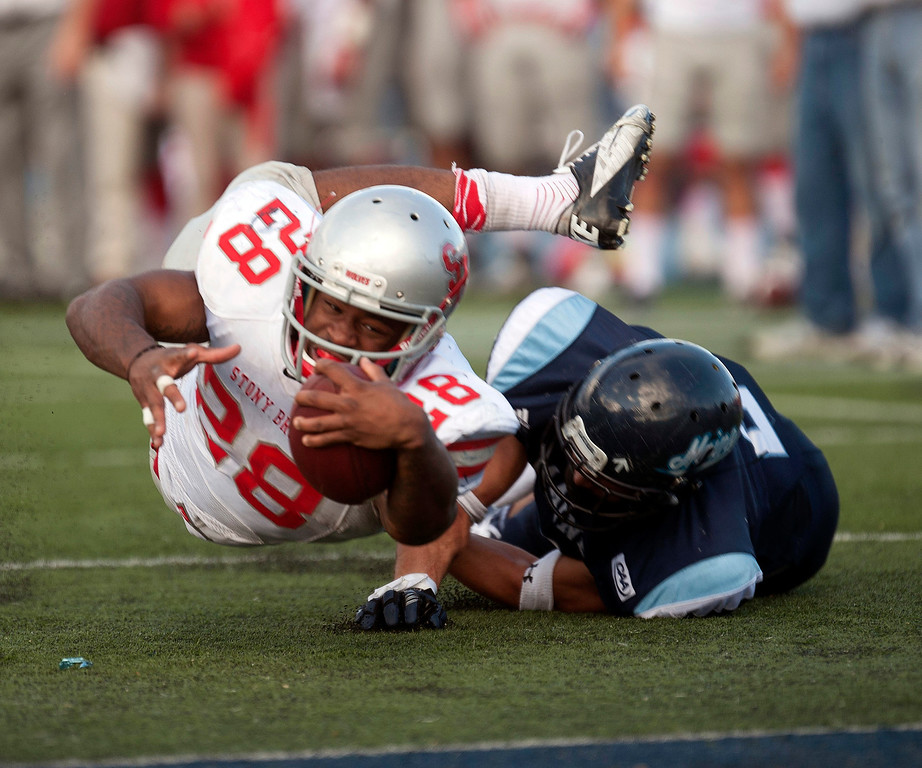 . Stony Brook running back James Kenner (28) stretches for the end zone after being tackled by Maine defensive back Cabrinni Concalves (2) in the second half of an NCAA college football game in Orono, Maine, Saturday, Nov. 2, 2013. (AP Photo/Michael C. York)