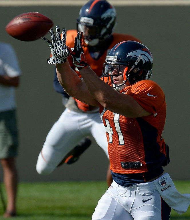. Denver Broncos S Ross Rasner (41) catches a pass during training camp August 6, 2013 at Dove Valley. (Photo By John Leyba/The Denver Post)