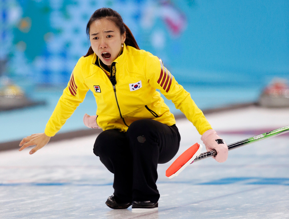 . South Korea\'s skip Kim Ji-sun reacts after her throw during women\'s curling competition against Canada at the 2014 Winter Olympics, Monday, Feb. 17, 2014, in Sochi, Russia. (AP Photo/Robert F. Bukaty)