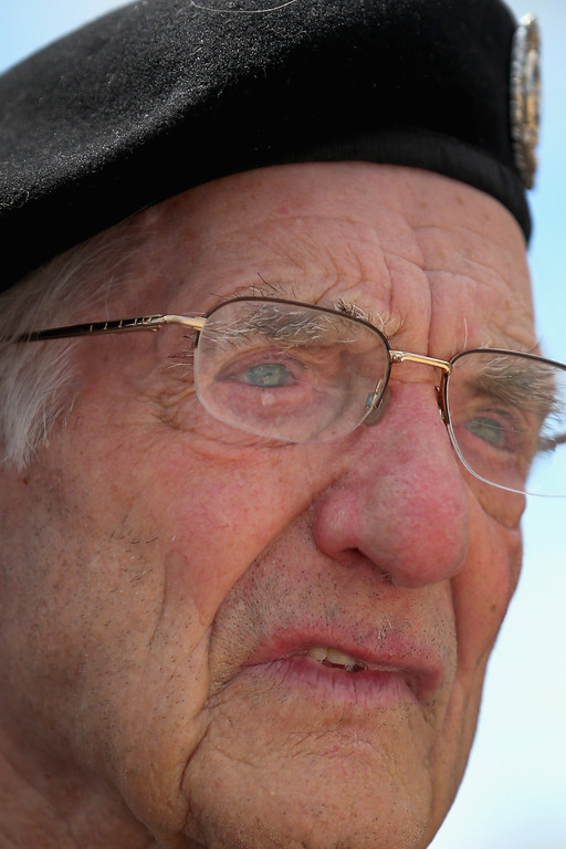 . Former Royal Engineer and D-Day veteran Gordon Smith, aged 90, from Newbury, sheds a tear during the Royal Artillery Commemoration Service and parade at Sword Beach on June 5, 2014 in Hermanville, France.   (Photo by Christopher Furlong/Getty Images)
