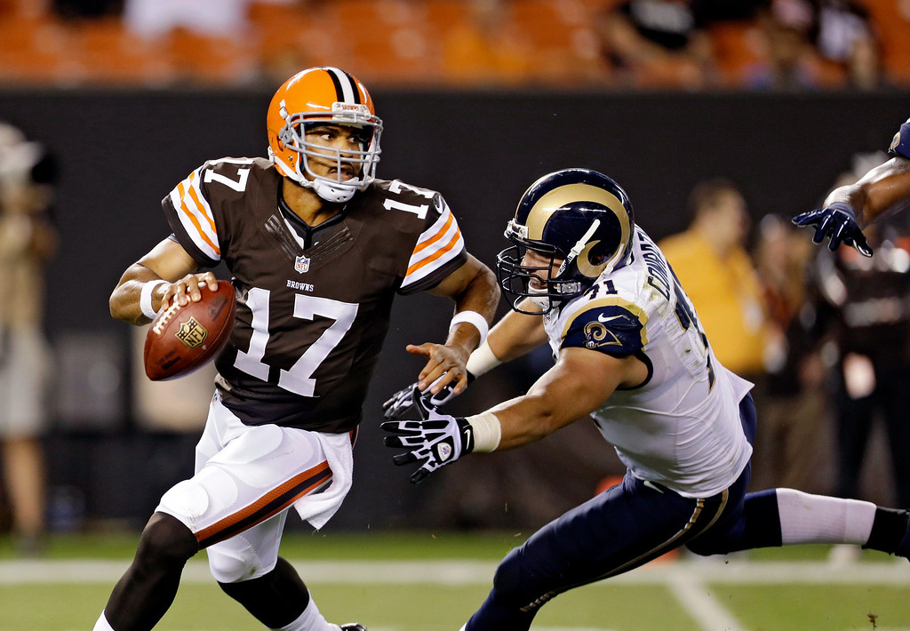 . Cleveland Browns quarterback Jason Campbell (17) is chased by St. Louis Rams\' Matt Conrath in the second quarter of a preseason NFL football game, Thursday, Aug. 8, 2013, in Cleveland. (AP Photo/Tony Dejak)