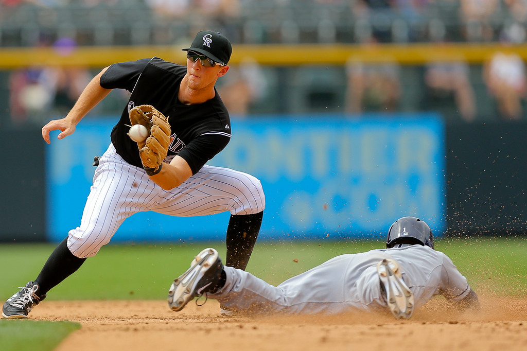 . DENVER, CO - JULY 9:  Irving Falu #1 of the San Diego Padres steals second base before second baseman DJ LeMahieu #9 of the Colorado Rockies can receive the throw during the sixth inning at Coors Field on July 9, 2014 in Denver, Colorado. (Photo by Justin Edmonds/Getty Images)