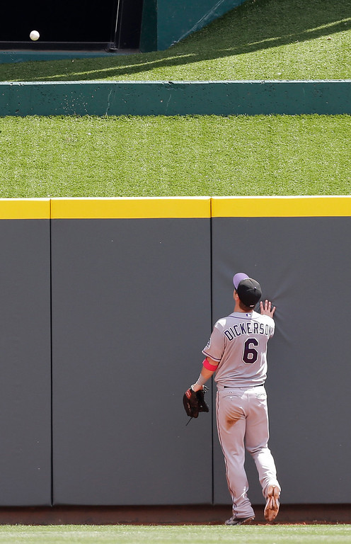 . Colorado Rockies center fielder Corey Dickerson watches a home run hit by Cincinnati Reds\' Todd Frazier in the fourth inning of a baseball game, Sunday, May 11, 2014, in Cincinnati. (AP Photo/Al Behrman)