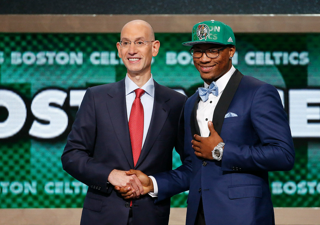 . Oklahoma State\'s Marcus Smart, right, poses for a photo with NBA commissioner Adam Silver after being selected sixth overall by the Boston Celtics during the 2014 NBA draft, Thursday, June 26, 2014, in New York. (AP Photo/Jason DeCrow)